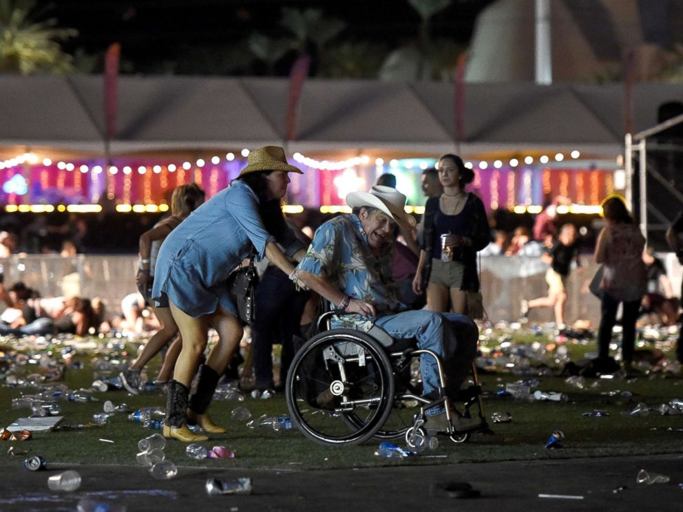 PHOTO: A man in a wheelchair is taken away from the Route 91 Harvest country music festival after gun fire was heard, Oct. 1, 2017 in Las Vegas.