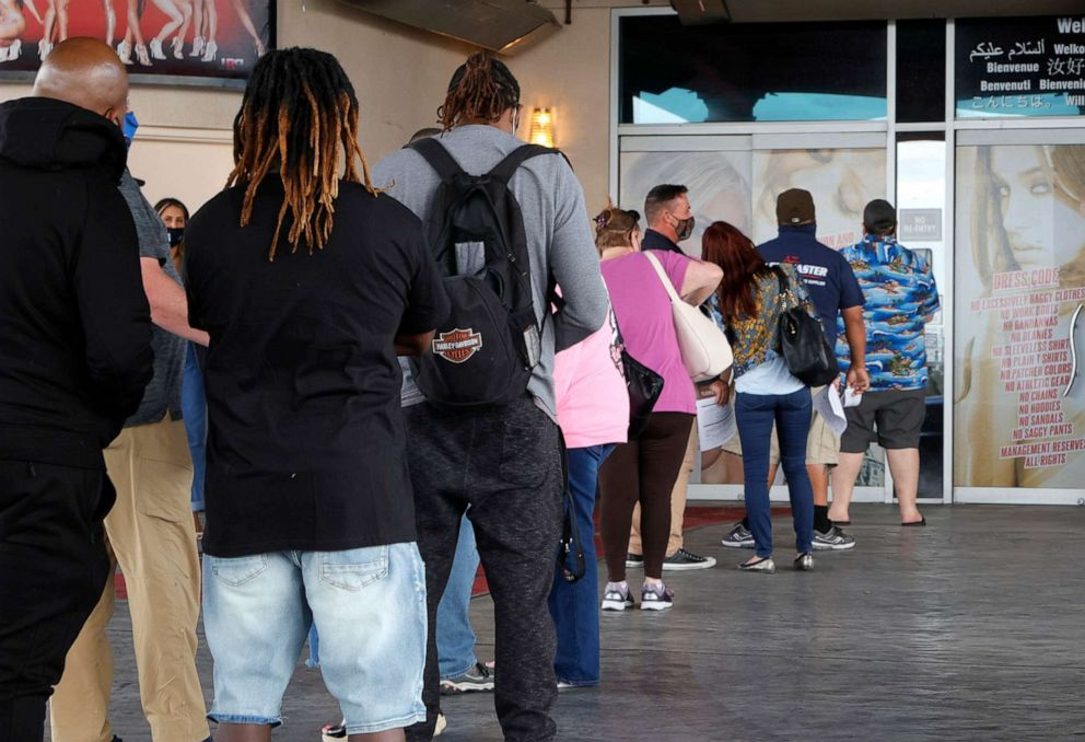 PHOTO: People line up to receive vaccinations at a pop-up COVID-19 vaccination clinic at Larry Flynt's Hustler Club on May 21, 2021, in Las Vegas.