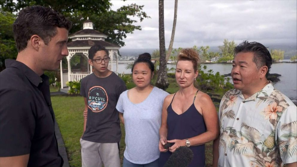 PHOTO: Kaming Li, right, his wife, Dawn and their children, Erica and Christopher, talk about their tour boat being hit by a lava bomb on July 16, 2018 when they went to see the lava flow from the erupting Kilauea volcano in Hawaii.