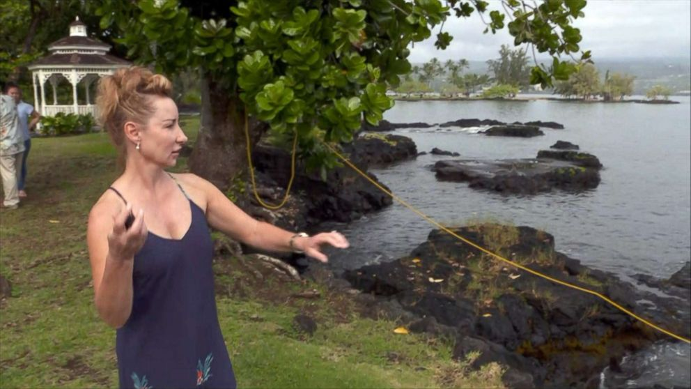PHOTO: Dawn Li throws a lava rock back into the ocean after it hit her while riding on a tour boat on July 16, 2018 in Hawaii.