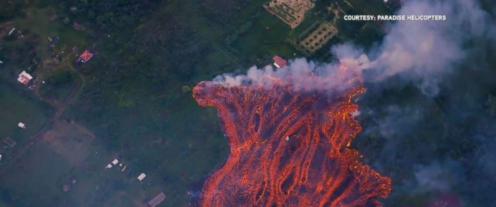 Large amounts of lava erupt from a fissure south of Leilani Estates in the Puna district of Hawaii, Saturday, May 19, 2018.