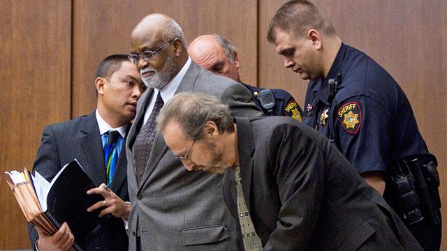PHOTO: Ronald Bridgeforth handcuffed by deputies in court