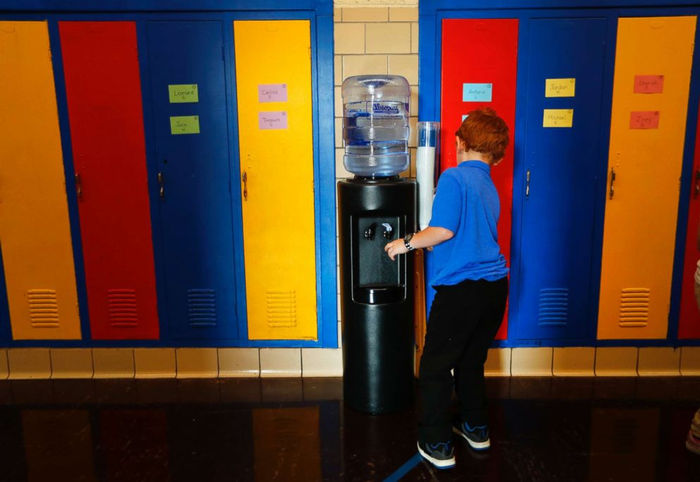 PHOTO: A student gets water from a cooler in the hallway at Gardner Elementary School in Detroit, Sept. 4, 2018.