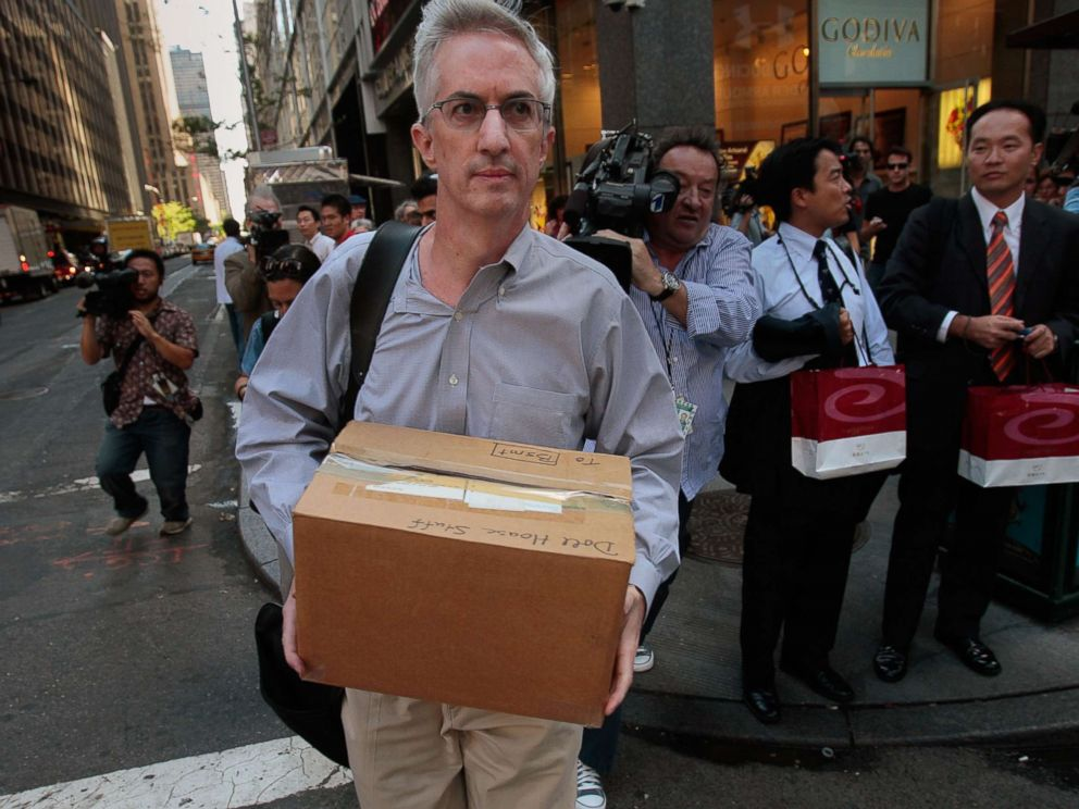 PHOTO: An employee of Lehman Brothers Holdings Inc. carries a box out of the companys headquarters building (background) Sept. 15, 2008 in New York.