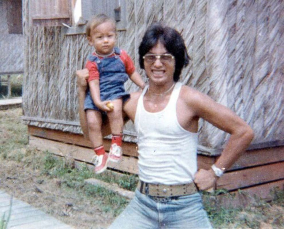 PHOTO: Tim Carters brother-in-law Lew Jones, who was the adopted son of Peoples Temple leader Jim Jones, is pictured with his son Chaeoke Jones at Jonestown in 1977. Lew Jones and his son died at Jonestown.