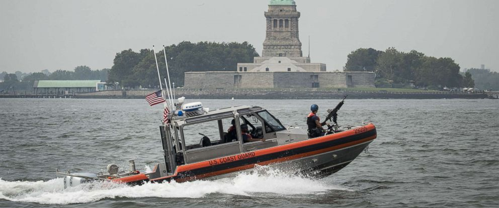 PHOTO: A Coast Guard boat cruises through New York Harbor after Liberty Island was evacuated when several propane tanks caught fire near the Statue of Liberty, Aug. 27, 2018 in New York.