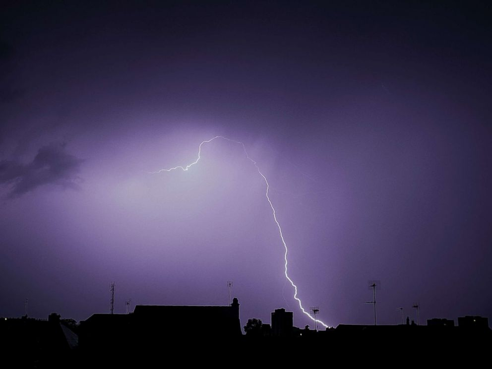 PHOTO: Lightning is seen during a storm over the roofs in Tours, France, Aug. 29, 2018.