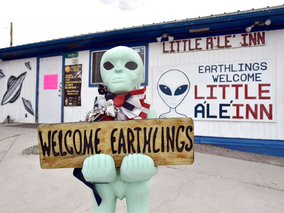 PHOTO: An alien-like statue displays a sign welcoming guests to the Little Ale Inn restaurant and gift shop, July 22, 2019, in Rachel, Nevada.