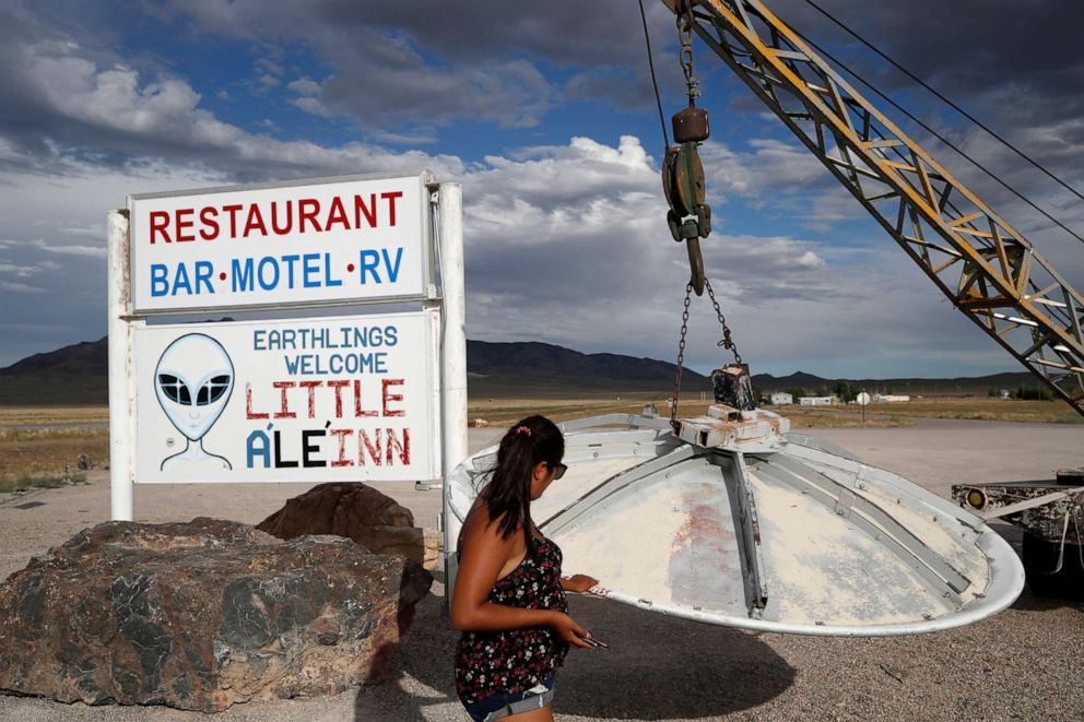 PHOTO: Grace Capati looks at a UFO display outside of the Little ALeInn, in Rachel, Nev., the closest town to Area 51, July 22, 2019.