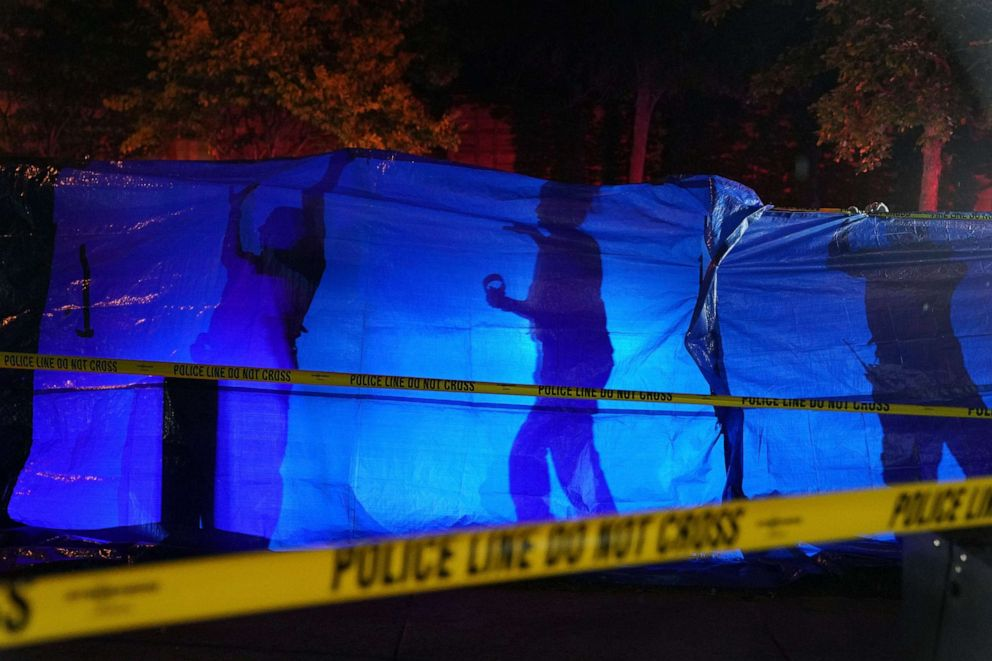 PHOTO: Police put up a blue tarp to block the view of a body at the scene of an officer involved shooting in Richfield, Minn., Saturday night, Sept. 7, 2019.