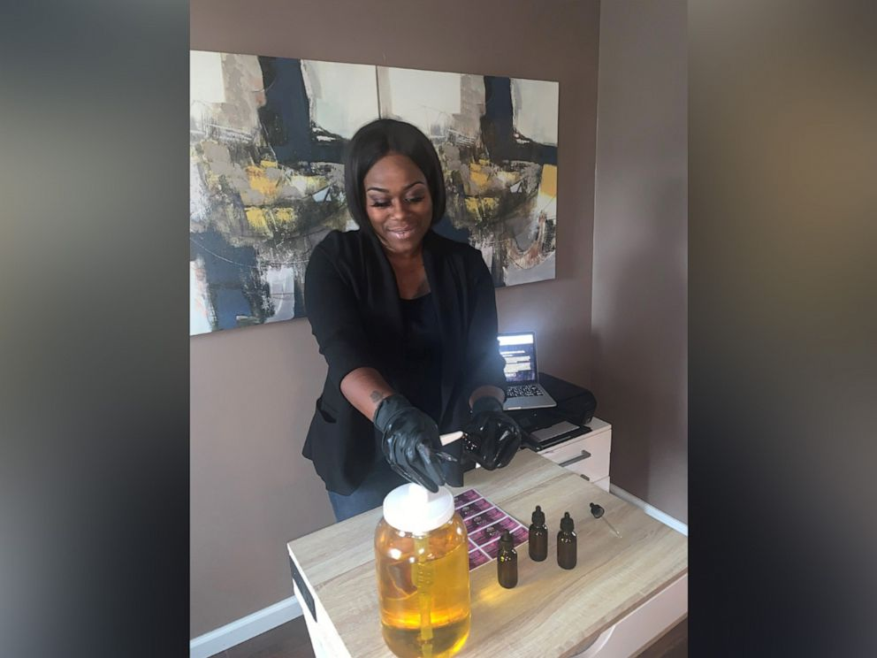 PHOTO: Londie Nichole mixes and bottles the oil. She is working on mass manufacturing for the future. She named the oil after her daughter, McKenzie, who was born prematurely.