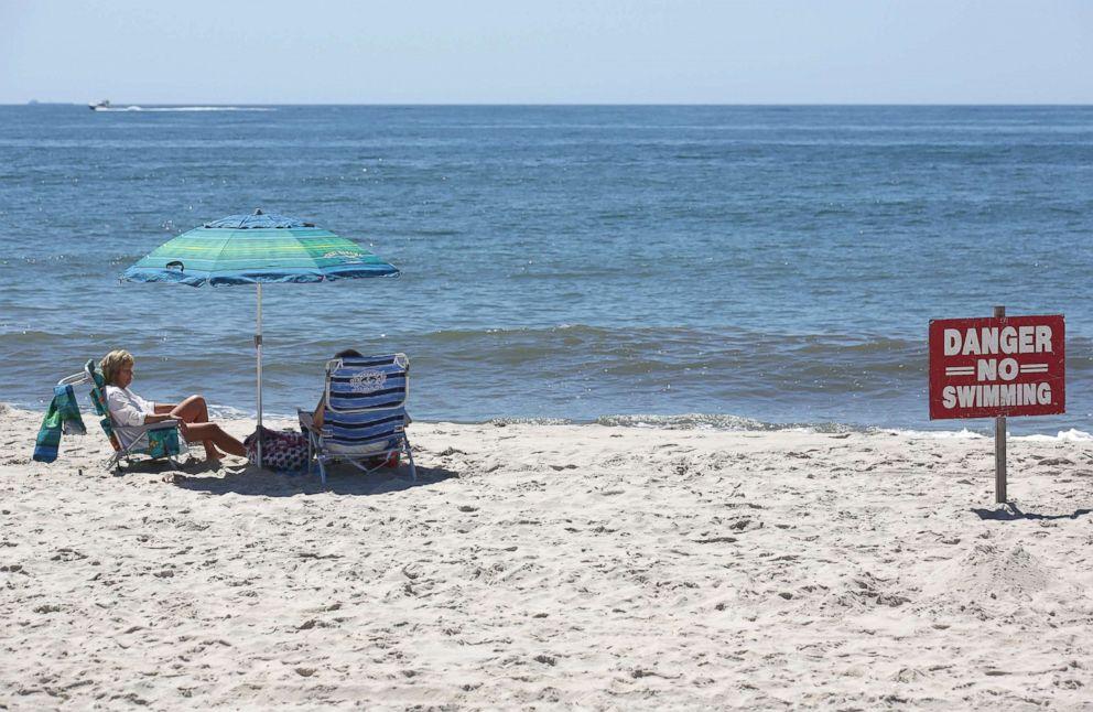 PHOTO: A no swimming sign is seen near Ocean Beach on Fire Island in Islip, N.Y., July 19, 2018.