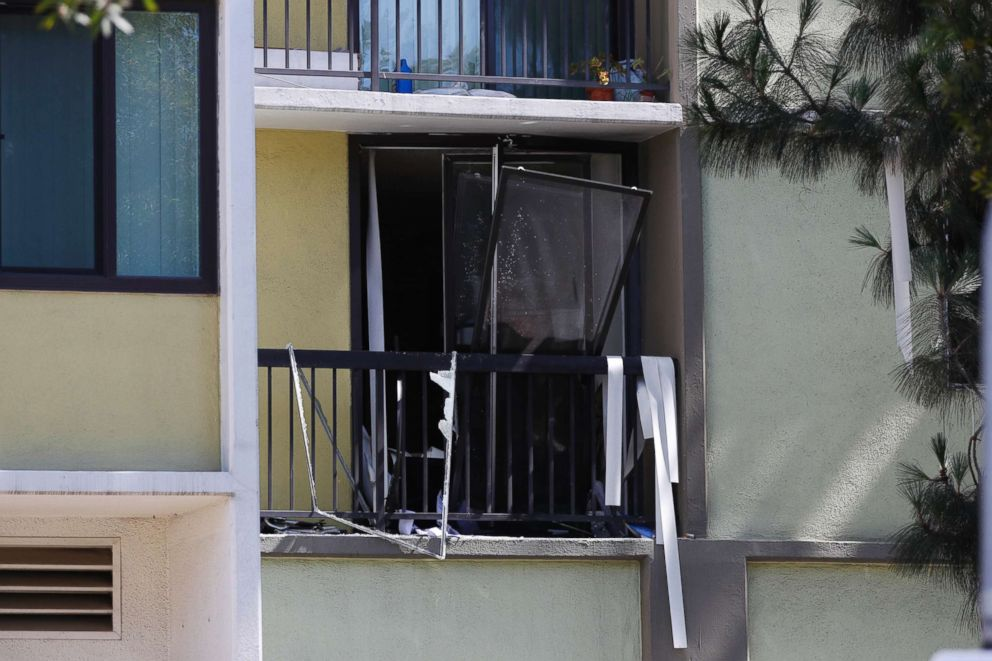 A broken window at a retirement home at the scene of a fatal shooting in Long Beach, Calif., June 25, 2018. A resident of a retirement home in Southern California opened fire on firefighters responding to a report of an explosion in the building, killing at least one and wounding others, officials said.