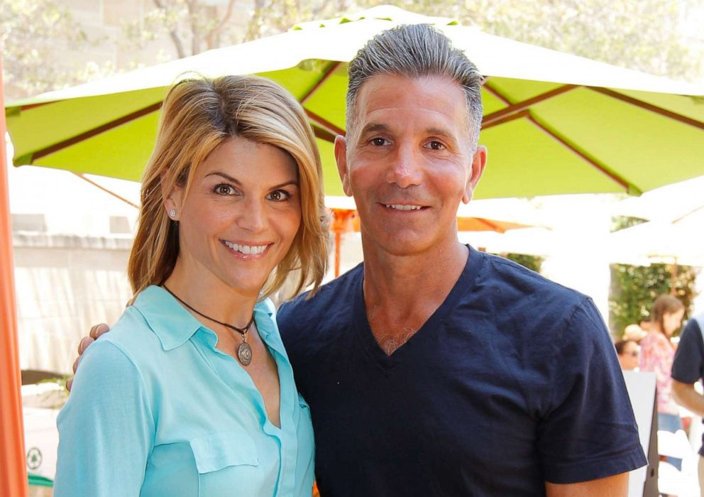PHOTO:Lori Loughlin and Mossimo Giannulli attend the 6th Annual Kidstock Music And Arts Festival, June 3, 2012, in Beverly Hills, Calif.