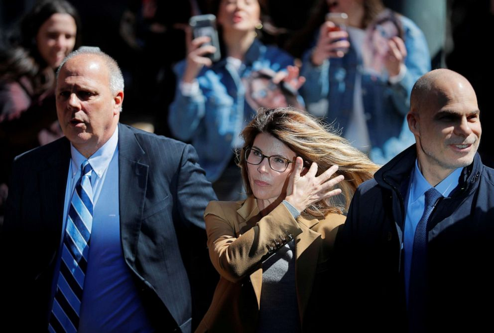 PHOTO: Actress Lori Loughlin, facing charges in a nationwide college admissions cheating scheme, is escorted to federal court in Boston, April 3, 2019.