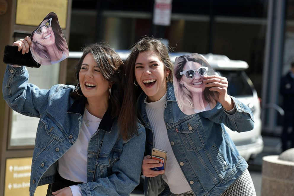 PHOTO: Fans of Lori Loughlin hold photo masks of Loughlin before she enters a courthouse in Boston to answer charges stemming from college admissions scandal on April 3, 2019.