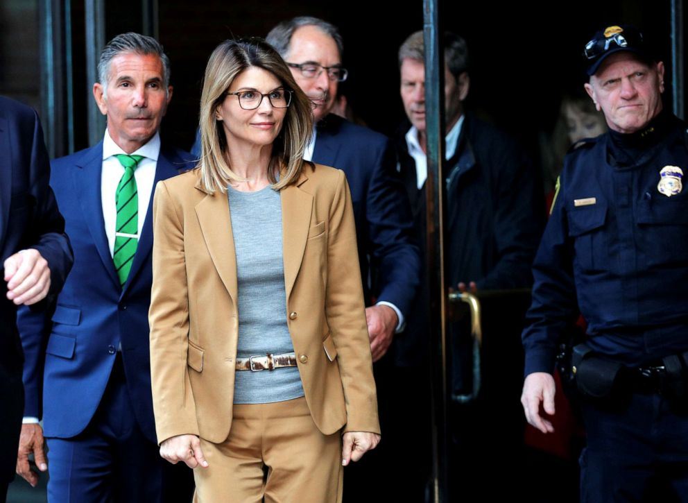 PHOTO: Lori Loughlin, and husband Mossimo Giannulli facing charges in a nationwide college admissions cheating scheme, leave federal court in Boston, April 3, 2019.