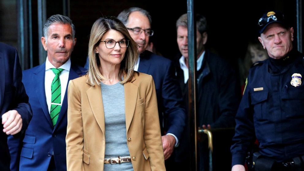 Lori Loughlin and husband Mossimo Giannulli facing charges in a nationwide college admissions cheating scheme leave federal court in Boston