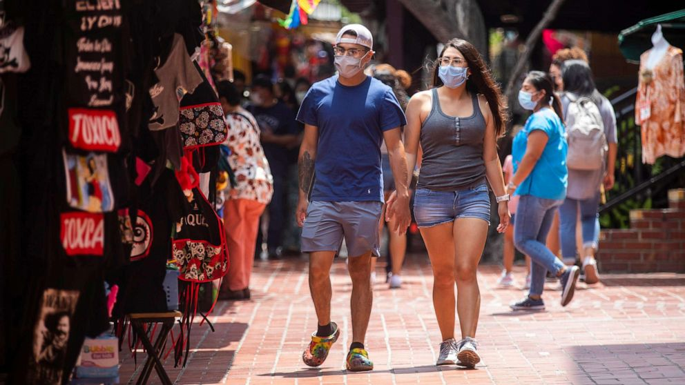 Mask mandates return at local level as some officials defy state rules