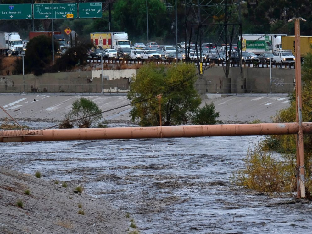 A file photo from Dec. 9, 2017 shows traffic at a standstill on the Interstate 5 freeway next to the Los Angeles River near downtown Los Angeles.