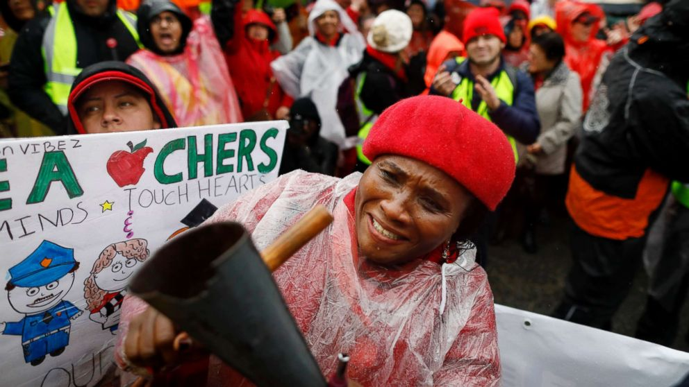 Teacher Nkechi Apakama along with Los Angeles Unified School District teachers and supporters gather at Los Angeles Unified School District headquarters on Jan. 14, 2019.