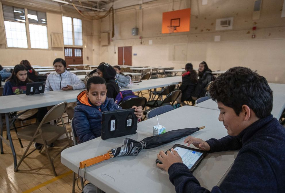 PHOTO: Burroughs Middle School students work on iPads in the gym at the school in Los Angeles, Calif., on Jan. 15, 2019.