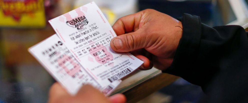 PHOTO: A customer purchases Mega Millions lottery tickets at a retailer in Washington, D.C., Oct. 22, 2018.