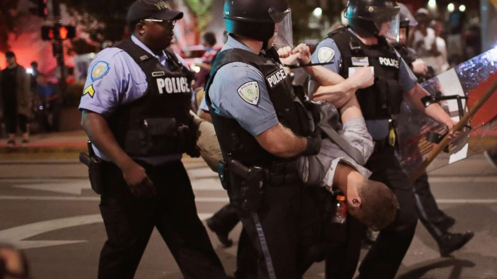 Police arrest a demonstrator protesting the acquittal of former St. Louis police officer Jason Stockley, Sept. 16, 2017, St. Louis.