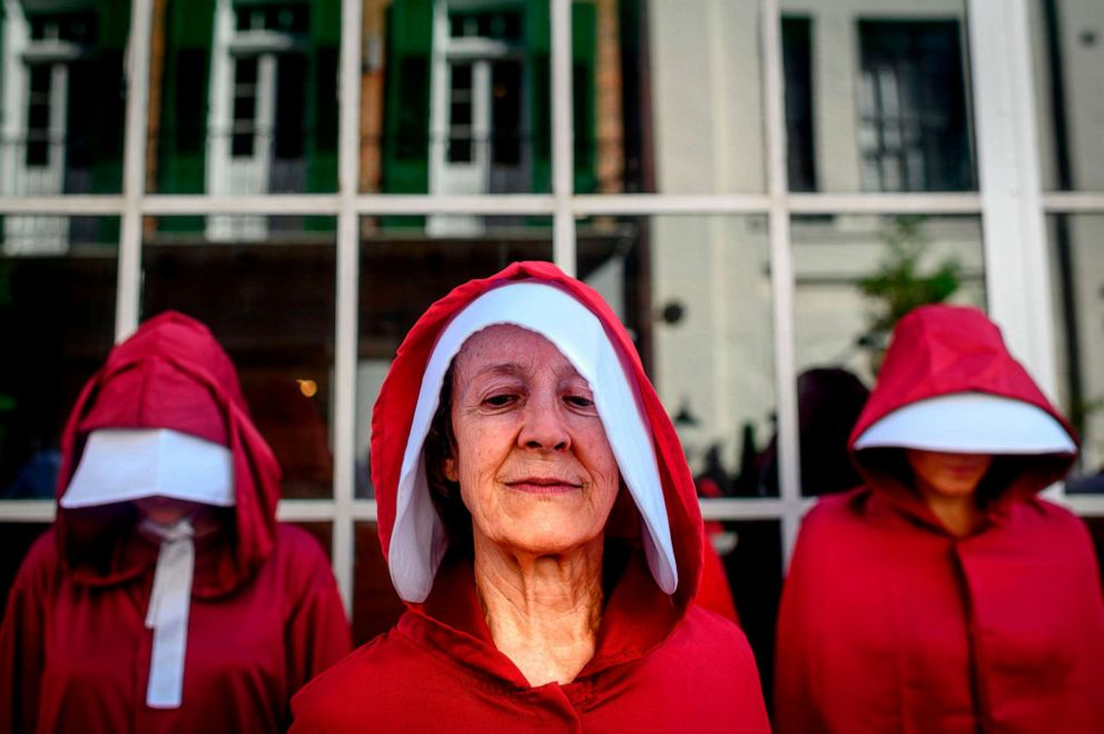 PHOTO: Protesters dressed as characters from the series The Handmaids Tale march in New Orleans on May 25, 2019, to protest the proposed Louisiana Heartbeat Bill.