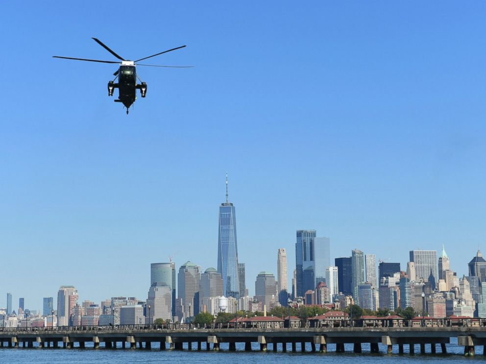 PHOTO: Marine One, with President Donald Trump on board, flies past the Manhattan skyline as it heads to the Liberty Park landing zone in Jersey City, N.J., Sunday, Oct. 1, 2017.