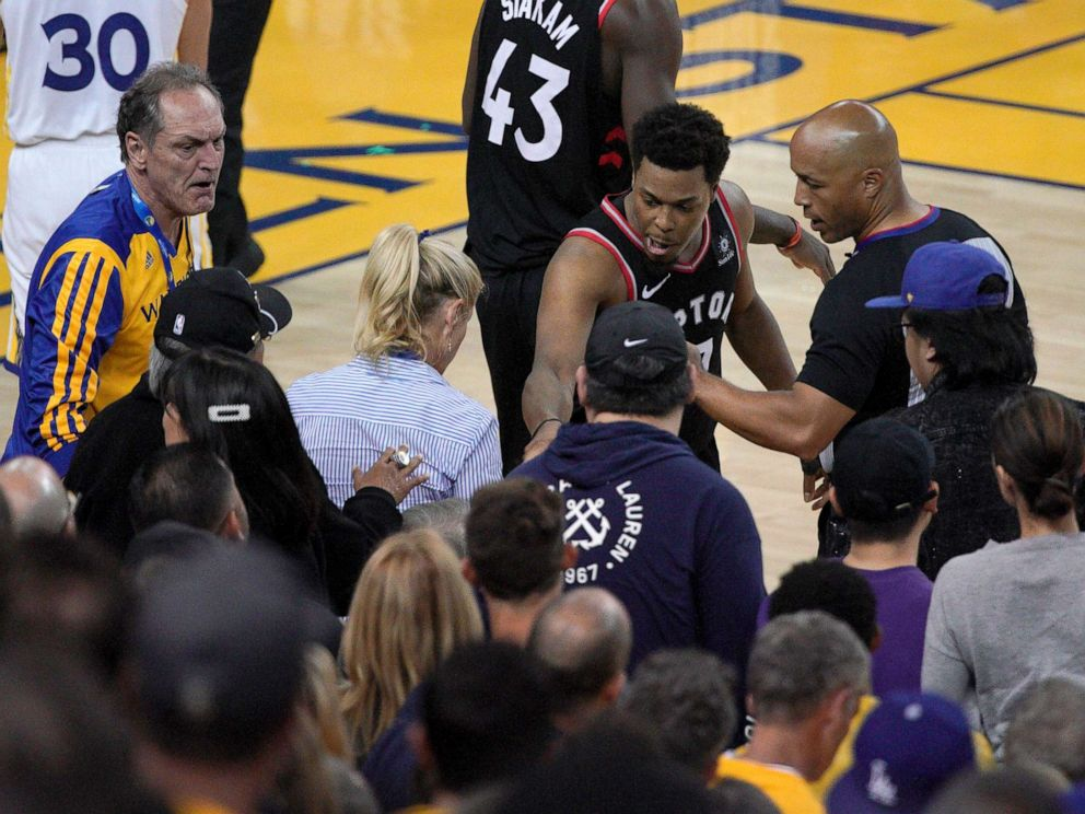 PHOTO: Toronto Raptors guard Kyle Lowry (7) gestures next to referees Marc Davis near the front row of fans during the NBA Finals between the Golden State Warriors and the Raptors in Oakland, Calif., June 5, 2019.