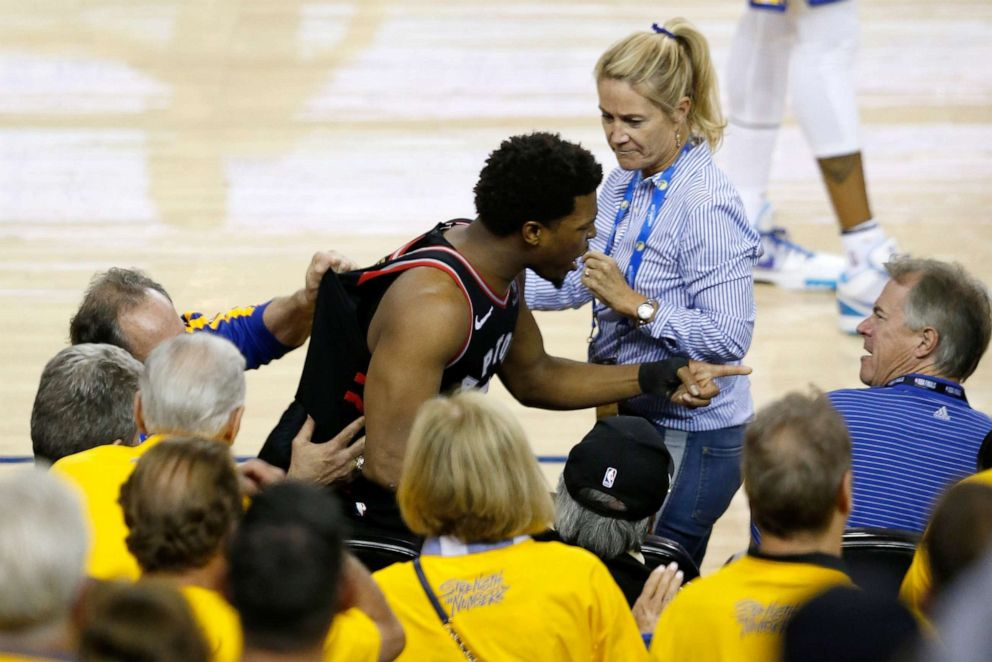 PHOTO: Kyle Lowry #7 of the Toronto Raptors yells at a fan in the second half against the Golden State Warriors during Game Three of the 2019 NBA Finals at ORACLE Arena, June 5, 2019. in Oakland, Calif.