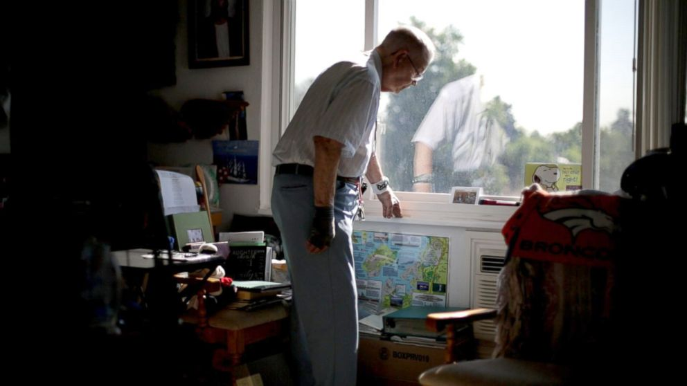 Loyd Leatherman looks out the window of his small apartment in Denver, Colorado. He is a Navy veteran and served as the mailman aboard the USS Oglethorpe.
