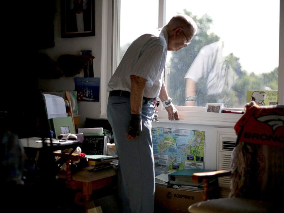 PHOTO: Loyd Leatherman looks out the window of his small apartment in Denver, Colorado. He is a Navy veteran and served as the mailman aboard the USS Oglethorpe.