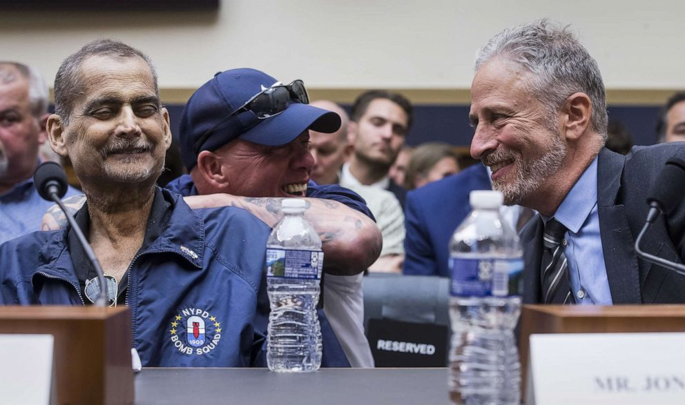 PHOTO: Former Daily show host Jon Stewart, right, speaks to retired police detective and 9/11 responder Luis Alvarez, left, during a hearing on reauthorization of the September 11th Victim Compensation Fund, June 11, 2019, in Washington, D.C.