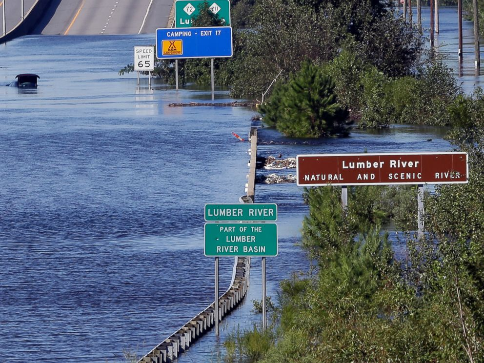 PHOTO: The Lumber River overflows onto a stretch Interstate 95 in Lumberton, N.C., Tuesday, Sept. 18, 2018, following flooding from Hurricane Florence.