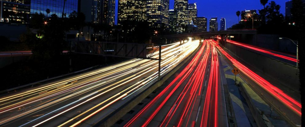 PHOTO: A long exposure shows motorists commuting during the evening rush hour on the 110 Freeway in downtown Los Angeles, December 2014.