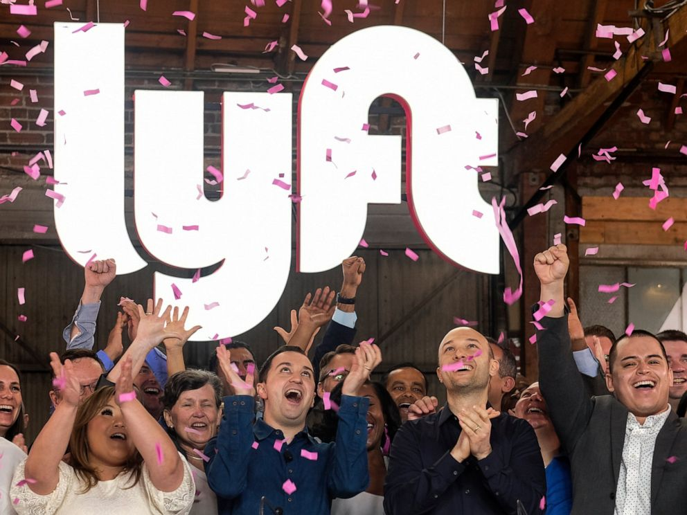 PHOTO: In this Friday, March 29, 2019 file photo, Lyft co-founders John Zimmer, front second from left, and Logan Green, front second from right, cheer as they as they ring a ceremonial opening bell in Los Angeles, to mark trading on the Nasdaq exchange.