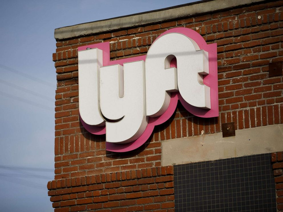 PHOTO: Signage is displayed outside of the Lyft Inc. driver hub in Los Angeles, Nov. 13, 2017.