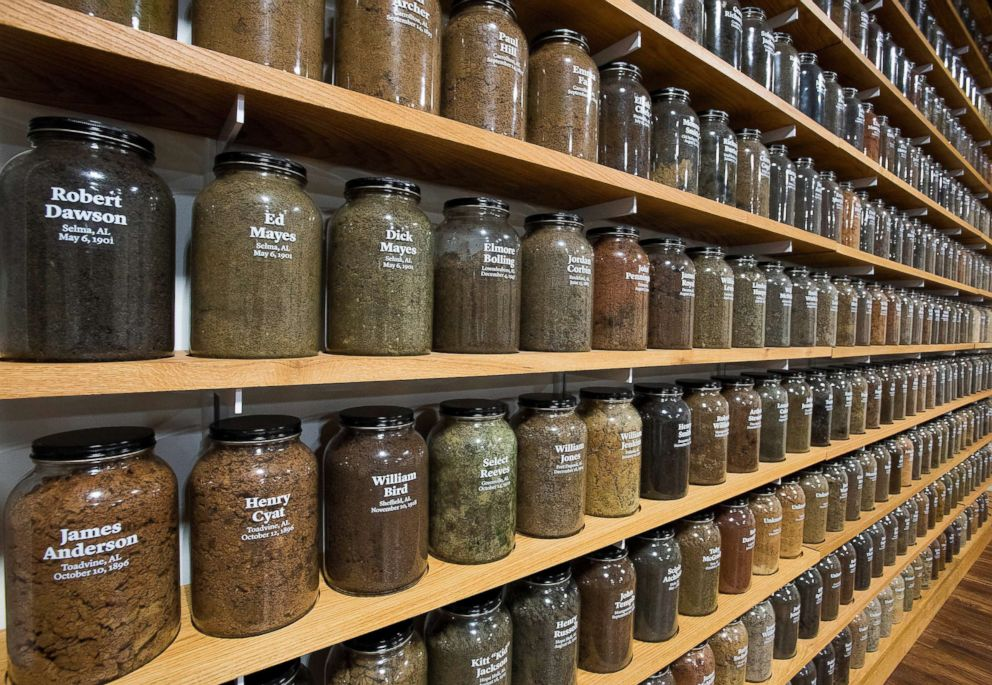 PHOTO: Jars containing soil from the sites of confirmed lynchings in the state of Alabama are displayed at the Equal Justice Initiative offices, April 13, 2018; Montgomery, Ala.