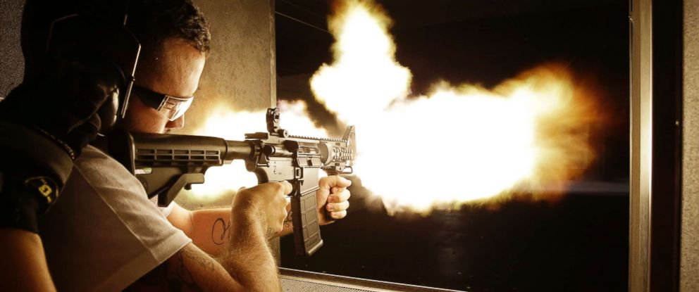 PHOTO: A client fires a fully automatic machine gun at a shooting range in Las Vegas on Aug. 28, 2014