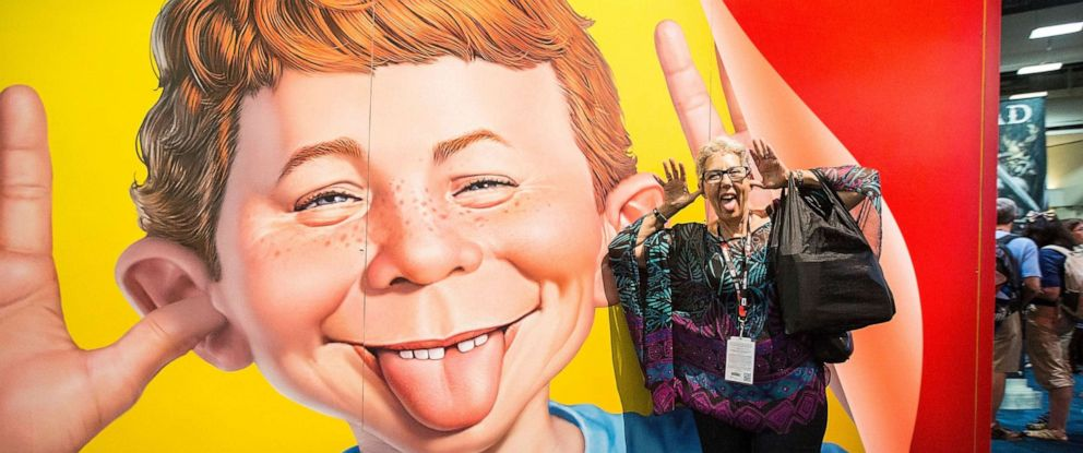 PHOTO: Attendee Judith Hawkins poses next to a display at the Mad Magazine booth at Comic-Con Preview Night on July 20, 2016 in San Diego, California.