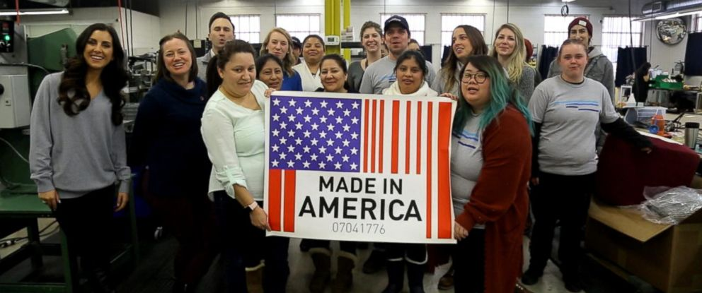 """PHOTO: Workers in Minneapolis hold up a """"Made in America"""" sign."""
