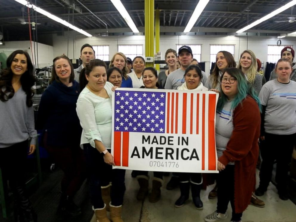 PHOTO: Workers in Minneapolis hold up a Made in America sign.