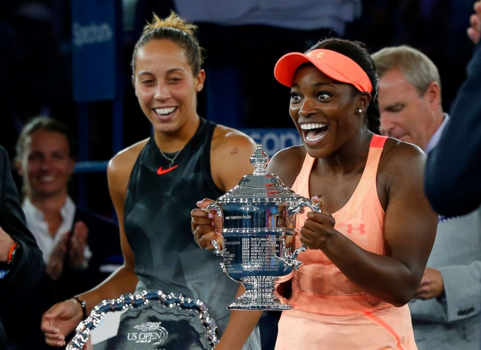 PHOTO: Sloane Stephens on the right, responding to the trophy after defeating Madison Keys left in the United States Open Women's Final in New York, September 9, 2017.