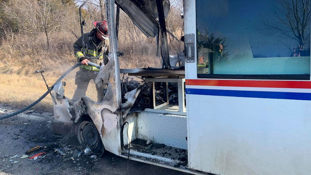 Postal Worker Saves Christmas Gifts When Mail Truck Bursts Into