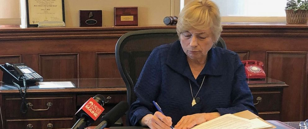 PHOTO: Maine Democratic Gov. Janet Mills signs a bill Wednesday, June 12, 2019, in her office in Augusta, Maine, becoming the eighth state to allow terminally ill people to end their lives with prescribed medication.