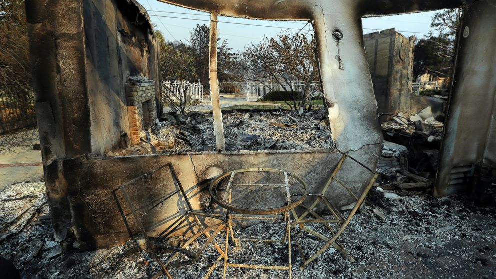 A table and chairs stand outside of one of at least 20 homes destroyed just on Windermere Drive in the Point Dume area of Malibu, Calif., Saturday, Nov. 10, 2018. Known as the Woolsey Fire, it has consumed thousands of acres and destroyed dozens of homes.
