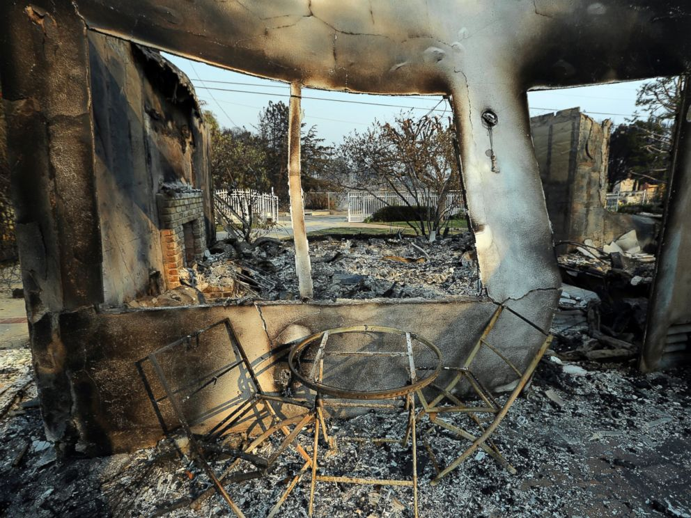 PHOTO: A table and chairs stand outside of one of at least 20 homes destroyed just on Windermere Drive in the Point Dume area of Malibu, Calif., Saturday, Nov. 10, 2018. Known as the Woolsey Fire, it has consumed thousands of acres and dozens of homes.