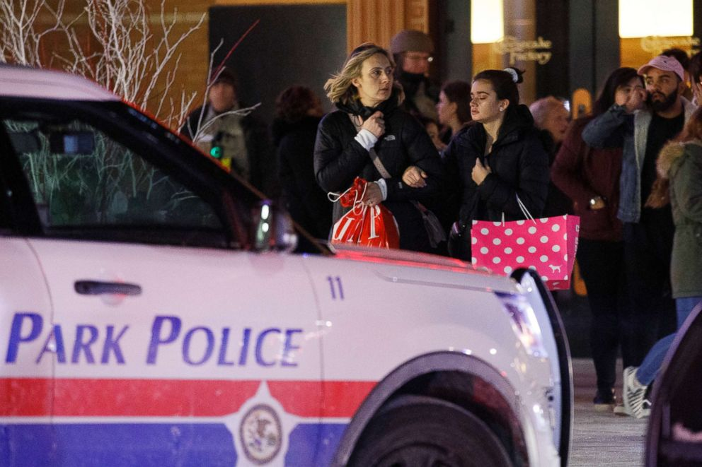 PHOTO: People leave the scene where a gunman shot and killed a man near the food court inside the Orland Square Mall, Jan. 21, 2019, in Orland Park, Ill.